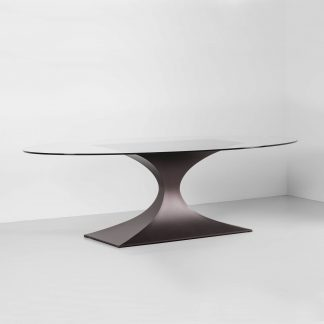 Capricorn contemporary dining table by Tom Faulkner